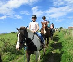 Pony riders on country lane